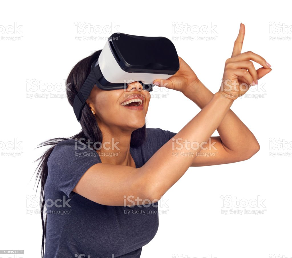 Woman exploring virtual reality. Reaching for an imaginary object stock photo