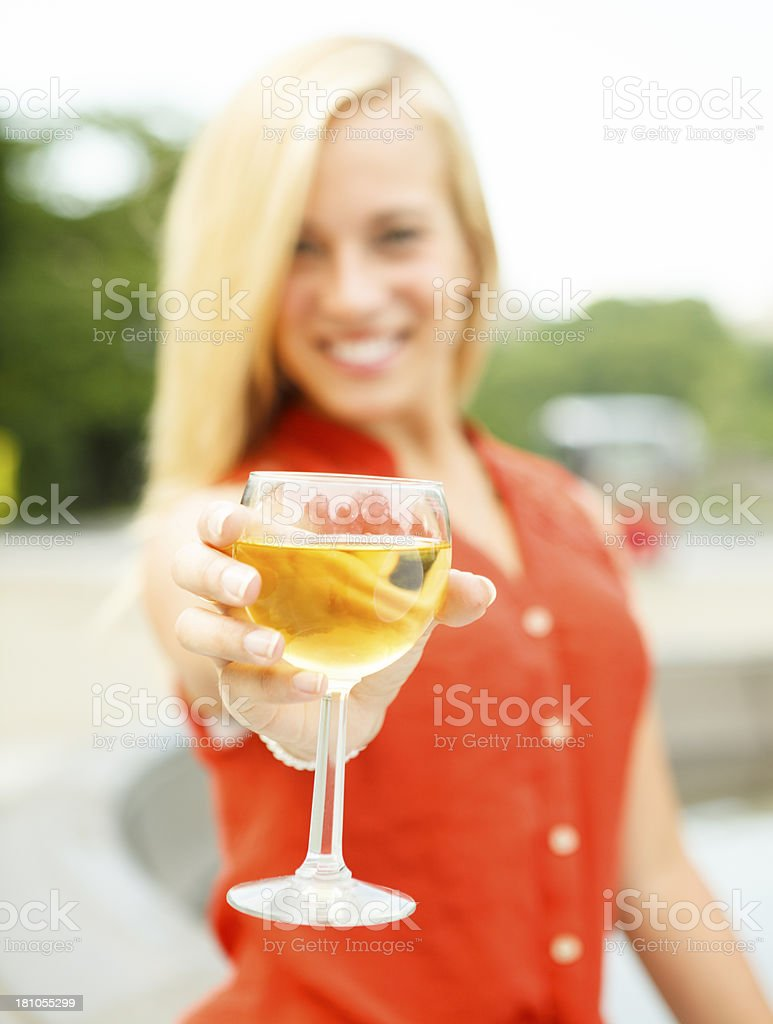 Woman Extends Wineglass royalty-free stock photo