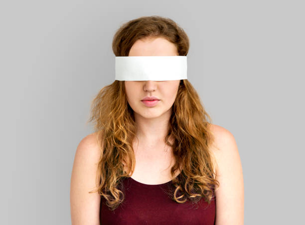 Woman Eye Covered Blind Forbidden Lost Concept stock photo