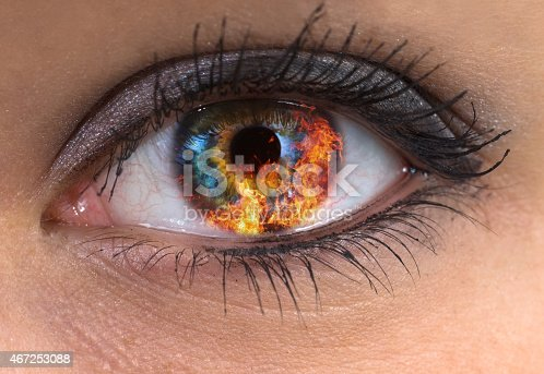 woman blue eye with burning fire in it