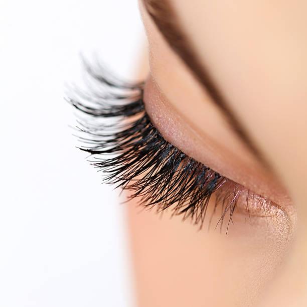 Woman eye with long eyelashes. Eyelash extension Woman eye with  long eyelashes. Eyelash extension false eyelash stock pictures, royalty-free photos & images