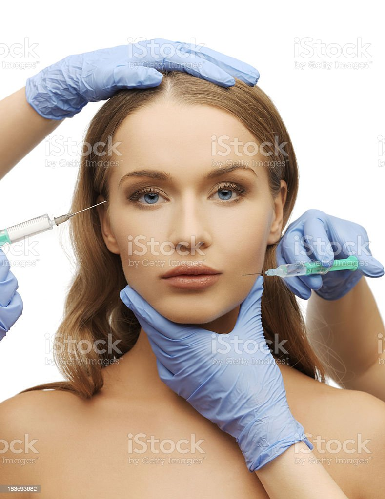 woman face and beautician hands with syringe royalty-free stock photo