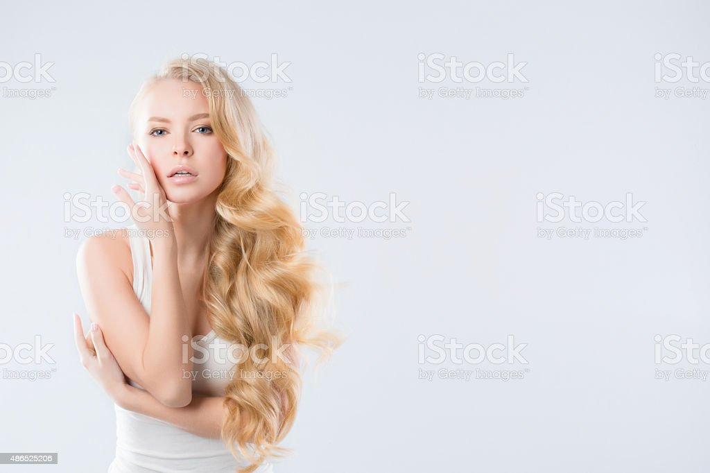 Woman face. Beautiful Woman with long curly hairstyle stock photo