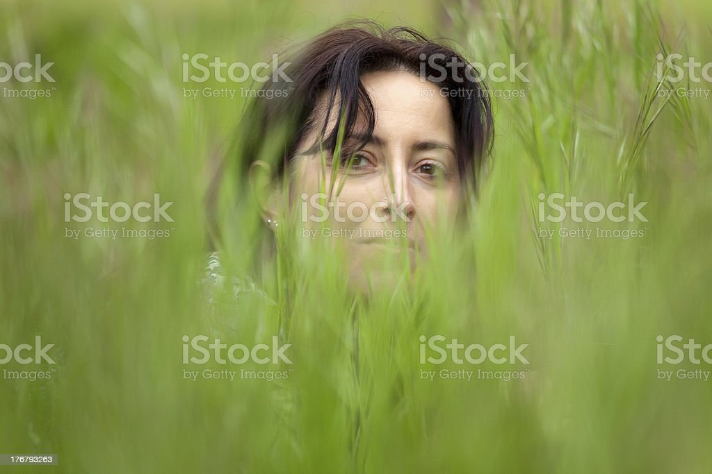 woman face in grass royalty-free stock photo