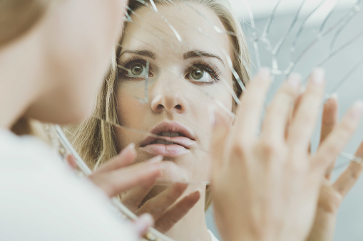 istock Woman face reflected in mirror 625741392