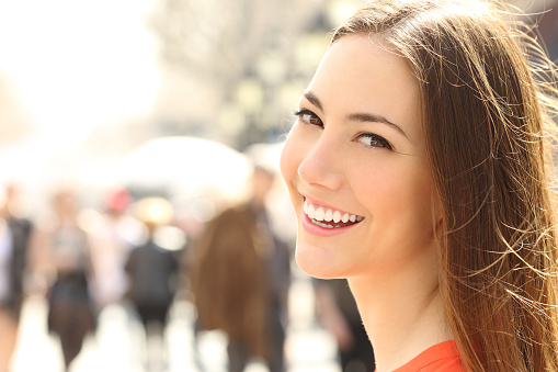 Woman face smile with perfect teeth looking you stock photo