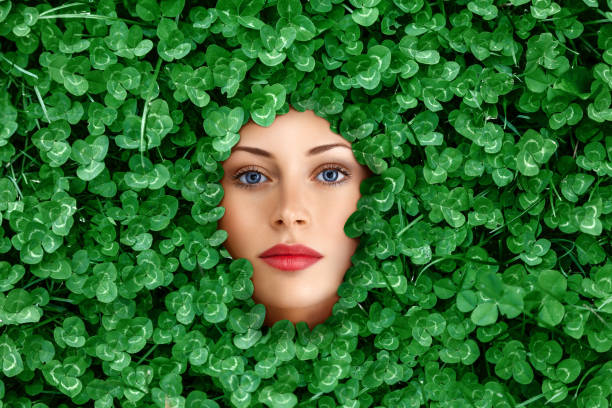 Woman face surrounded by grass stock photo