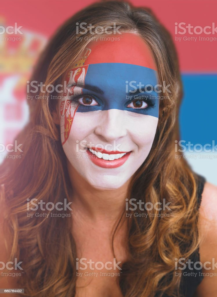 Woman face with painted flag of Serbia - fotografia de stock
