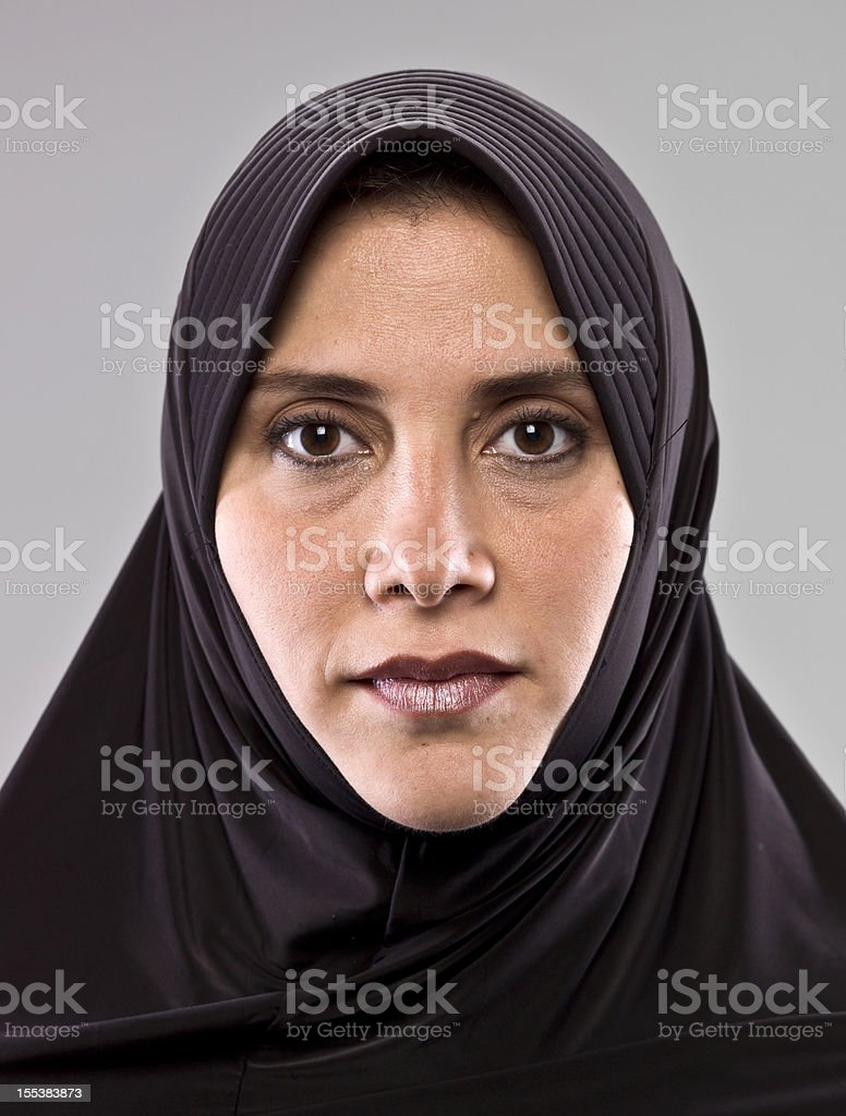 Woman facing forward with serious expression. royalty-free stock photo