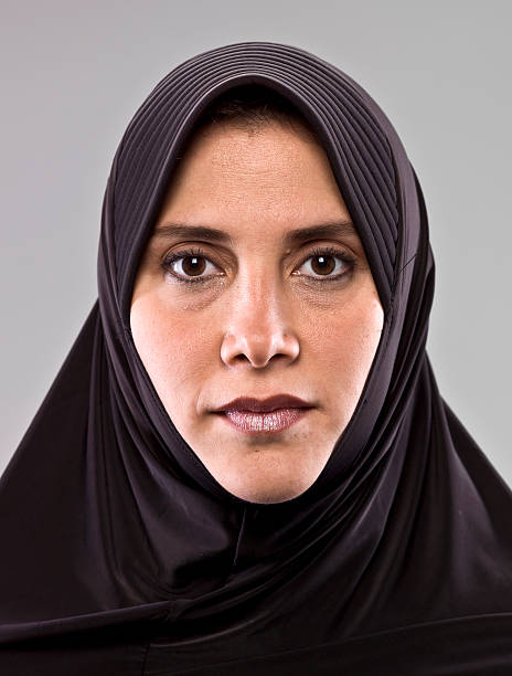 Woman facing forward with serious expression. stock photo