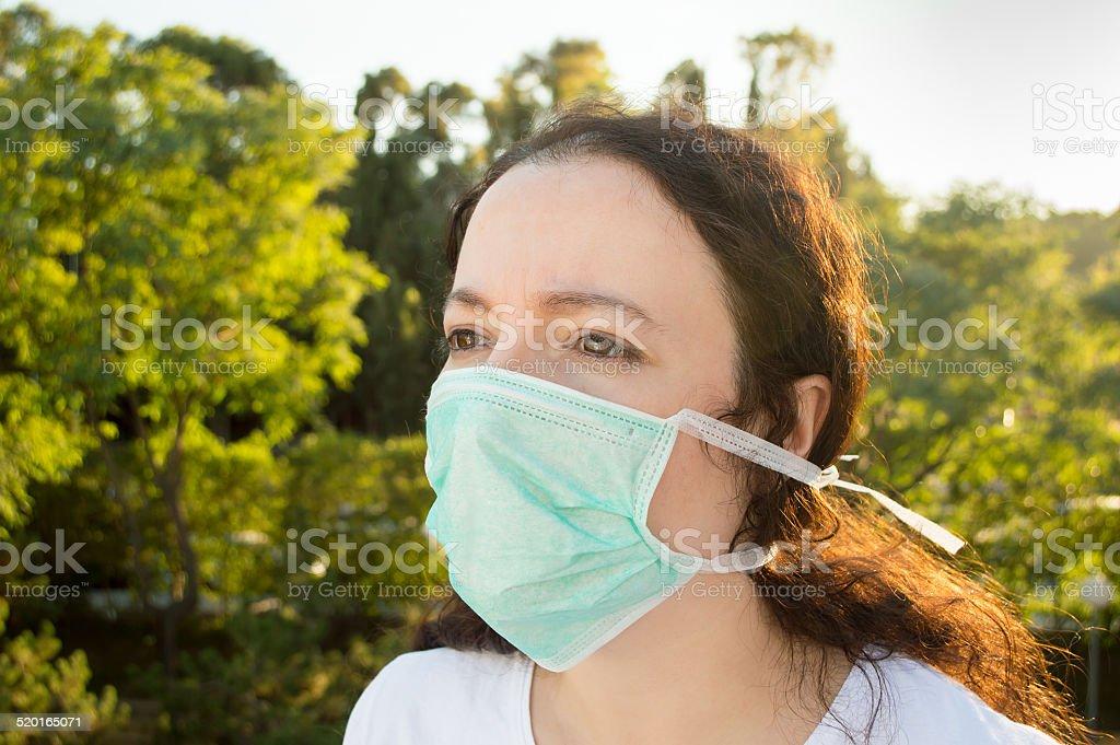 Woman facing pollution stock photo