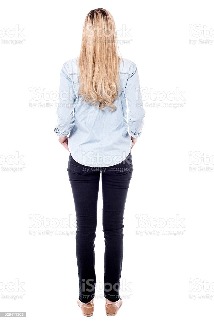 Woman facing towards wall stock photo