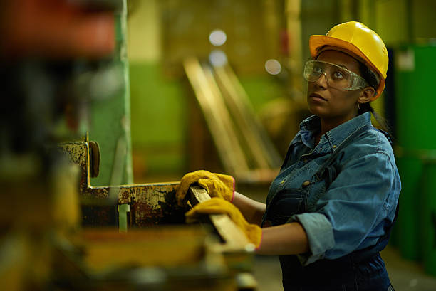 woman factory worker - manufacturing occupation stock photos and pictures