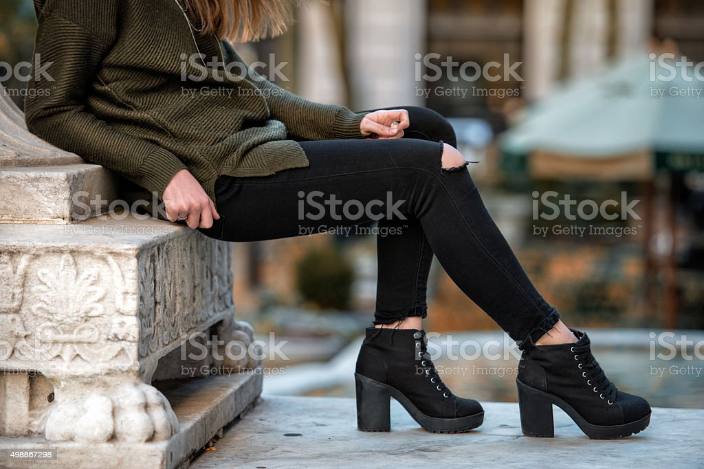Woman fall wear street style with black pants and sweater stock photo