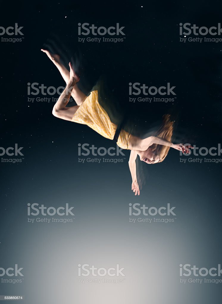Woman Falling In A Dream stock photo