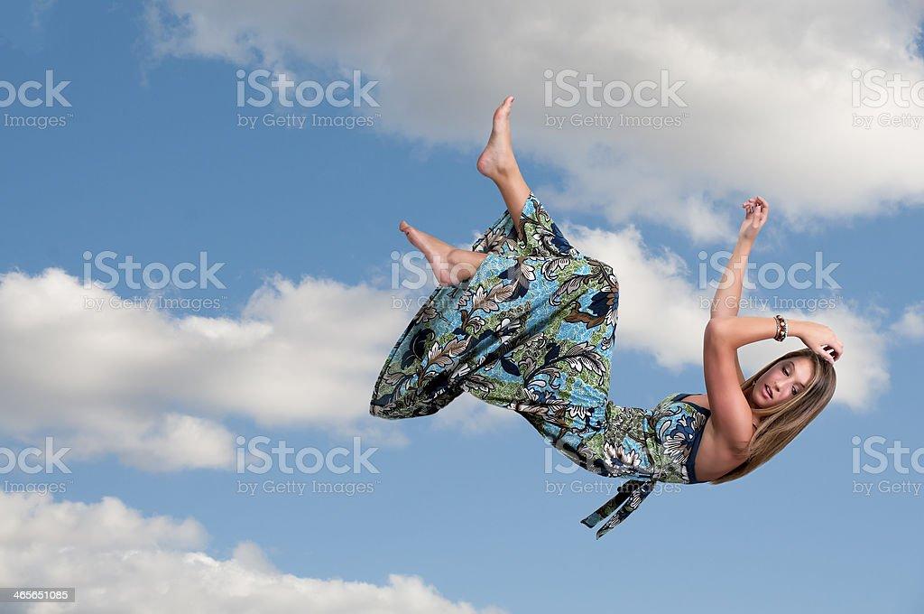 Woman Falling Through the Sky royalty-free stock photo