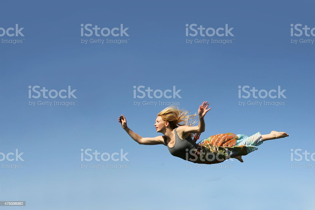 Woman Falling Through the Sky stock photo