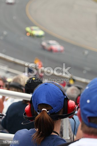 173015172 istock photo Woman Fan at Racing Event and Looking at Race 157381201