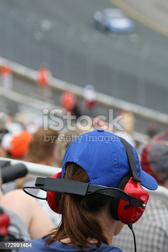 173015172 istock photo Woman Fan at Racing Event and Looking at Race 172991464