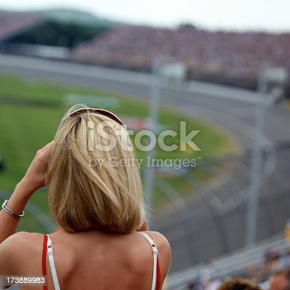 173015172 istock photo Woman Fan at Racing Event and Looking at Race 173889983