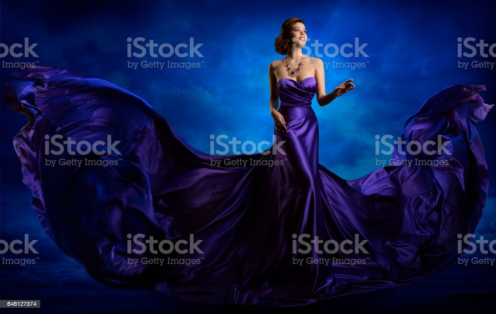 Woman Fashion Dress, Blue Gown Flying Waving Silk Fabric stock photo