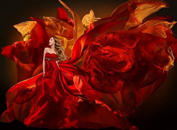 Woman Fashion Dress Flying Red Fabric, Beautiful Girl Waving Cloth stock photo