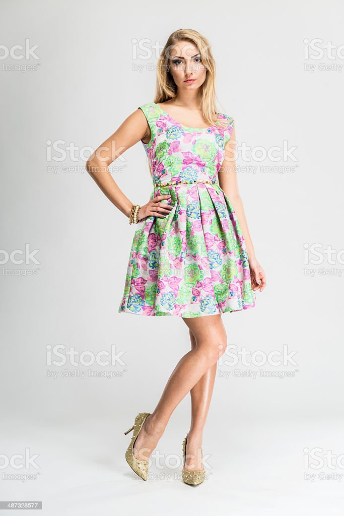 Woman, fashion model wears fashionable summer sleeveless dress, floral design stock photo