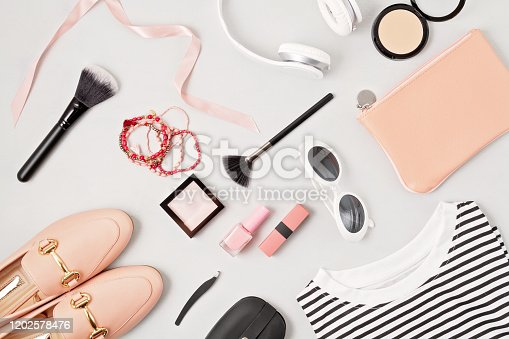 847905020 istock photo Woman fashion outfit and accessories, shoes, notepad, makeup and earphones in black and white colors. Beauty, urban outfit and fashion trends concept 1202578476