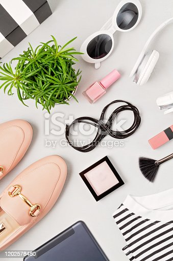 847905020 istock photo Woman fashion outfit and accessories, shoes, notepad, makeup and earphones in black and white colors. Beauty, urban outfit and fashion trends concept 1202578480