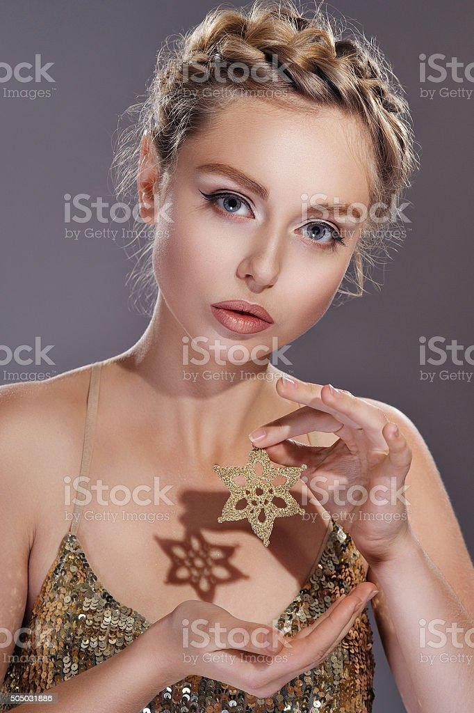 Woman fashion portrait with golden makeup stock photo