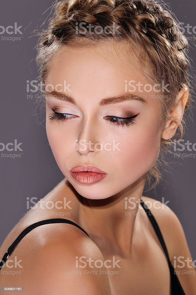 Woman fashion portrait with greek braids stock photo