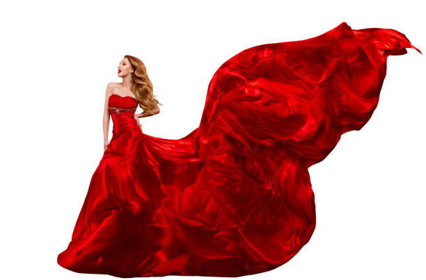 woman fashion red dress, gown waving on wind, flying fabric - lange abendkleider stock-fotos und bilder