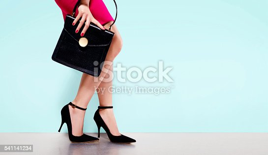 istock Woman fashion.black purse hand bag with high heels shoes. 541141234