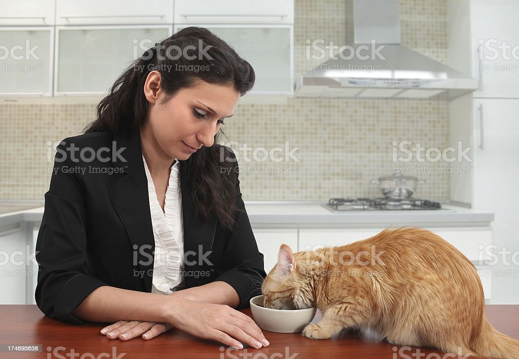 Woman Feeding Her Cat royalty-free stock photo