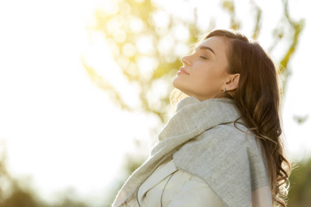 Woman feeling autumn Woman feeling autumn eyes closed woman stock pictures, royalty-free photos & images