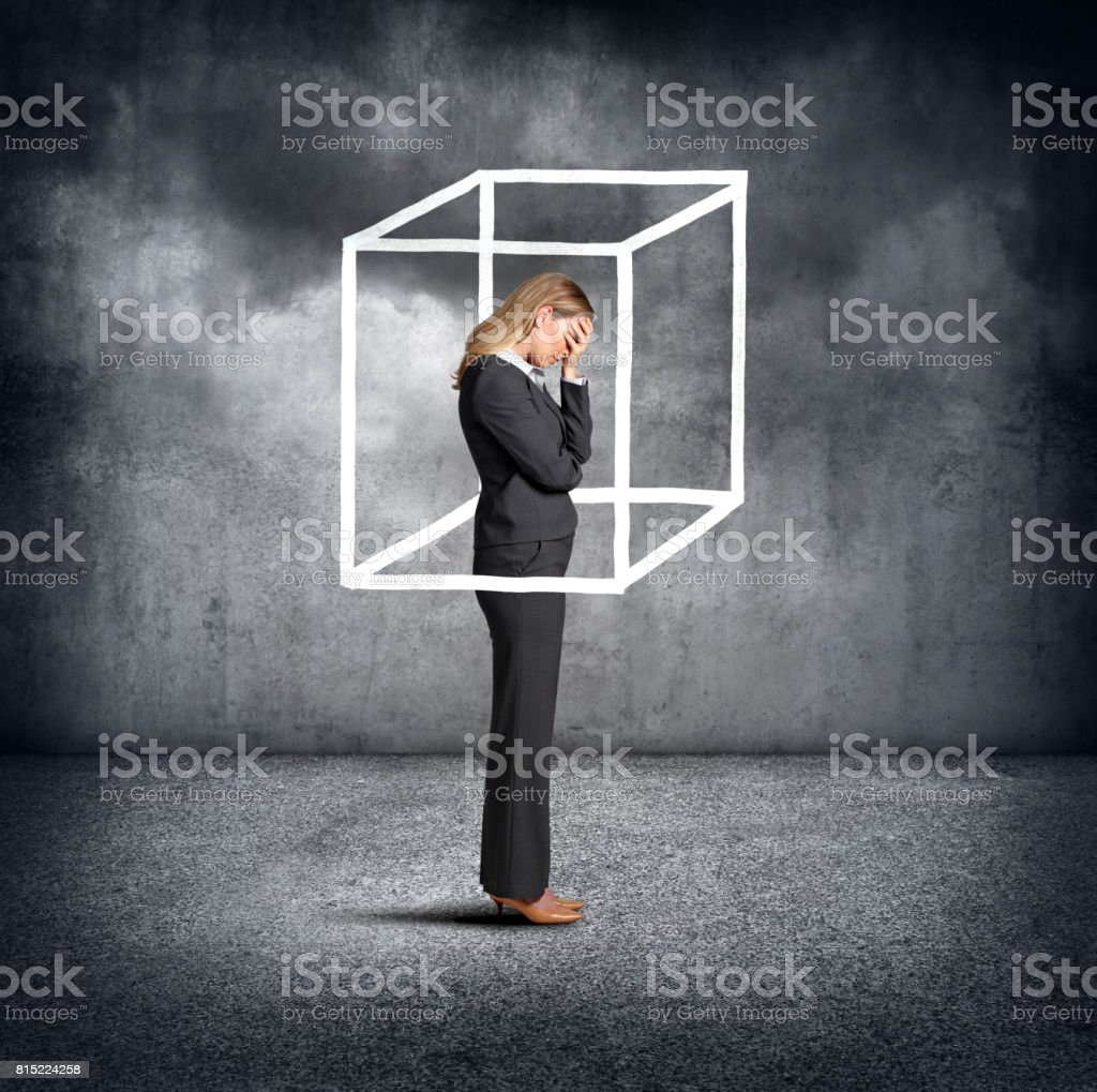Woman Feeling Boxed In stock photo