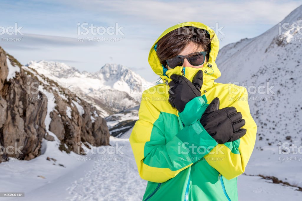 Woman feeling cold discomfort covering mouth and face from wind stock photo
