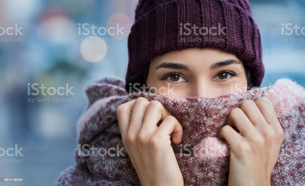 Woman feeling cold in winter stock photo