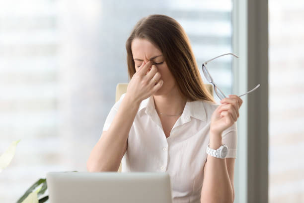 woman feeling discomfort from long wearing glasses - frowning stock photos and pictures