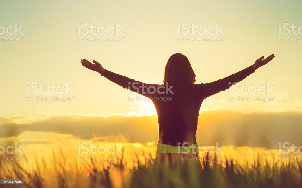 Woman feeling free in a beautiful natural setting stock photo
