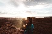 Silhouette of young woman enjoying the beautiful sunset above Valle De La Luna in Atacama desert, Chile
