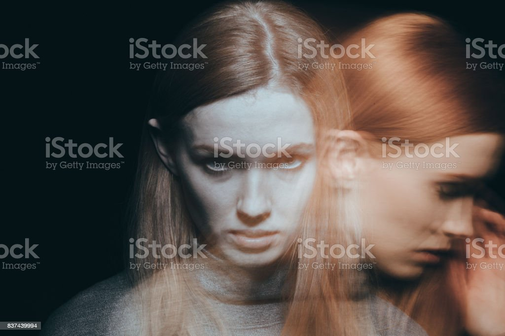 Woman feeling grief and sorrow stock photo