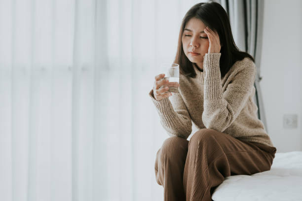 Woman feeling headache from flu and cold stock photo