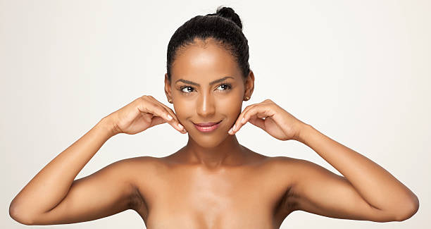 Woman feeling her smooth skin. stock photo