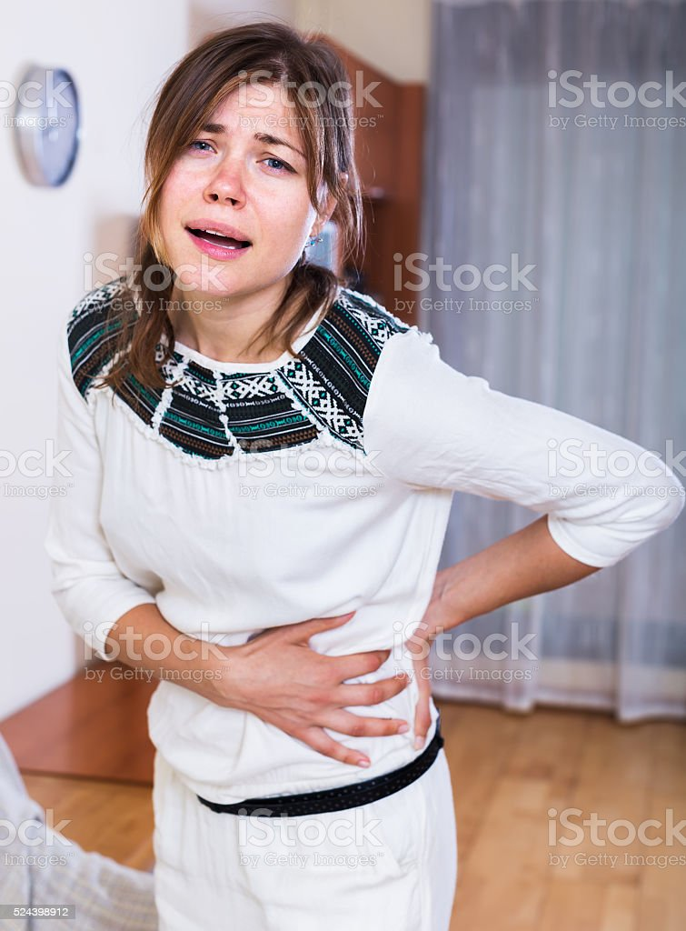 Woman feeling pain in the side stock photo