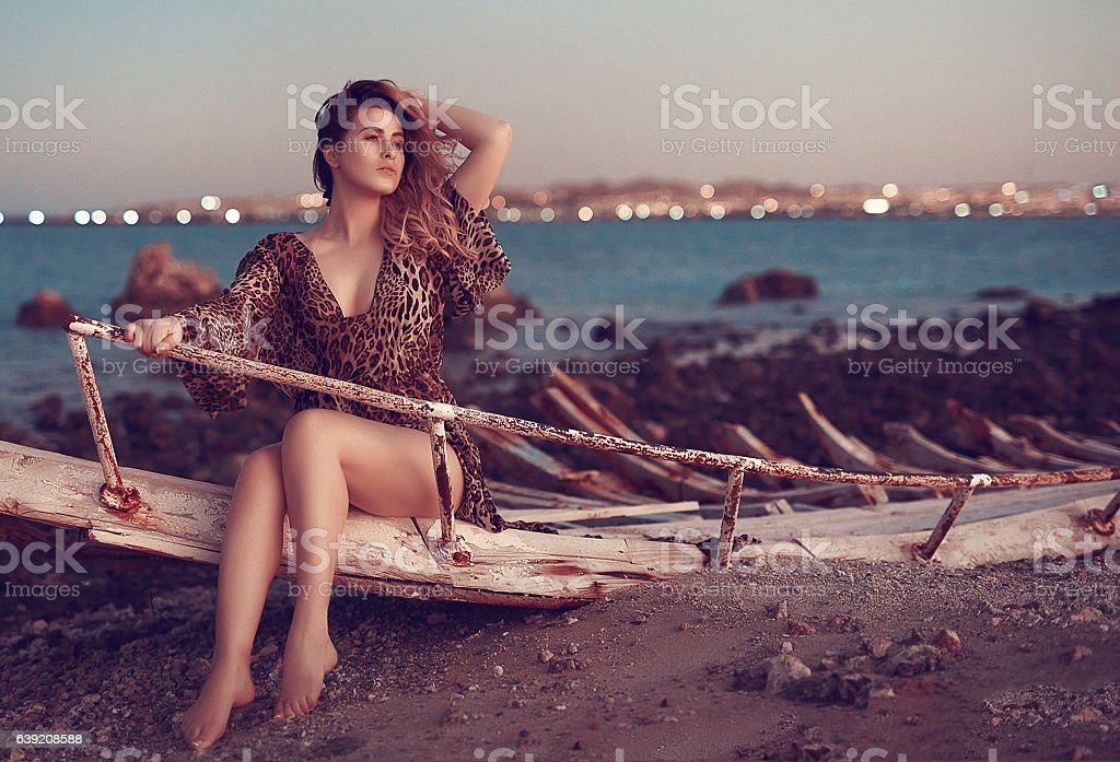 woman feeling seductive on the beach stock photo
