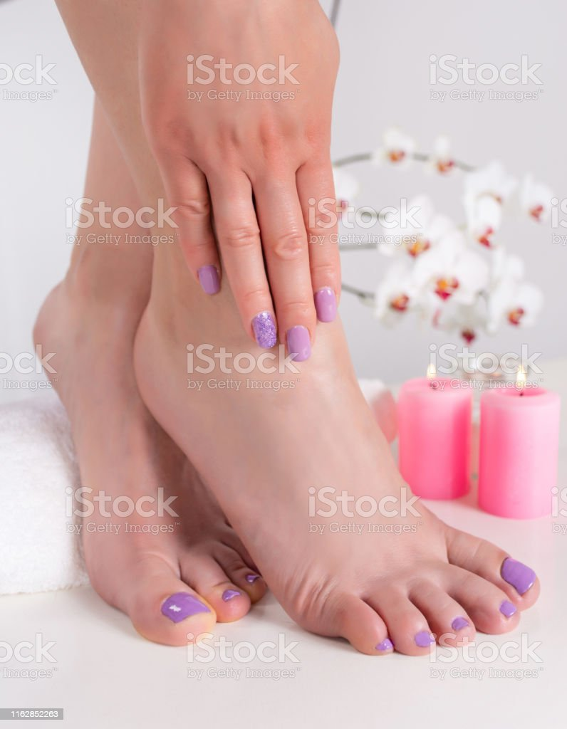 Woman Feet And Hands With Lilac Nails Polish Color Stock Photo Download Image Now Istock