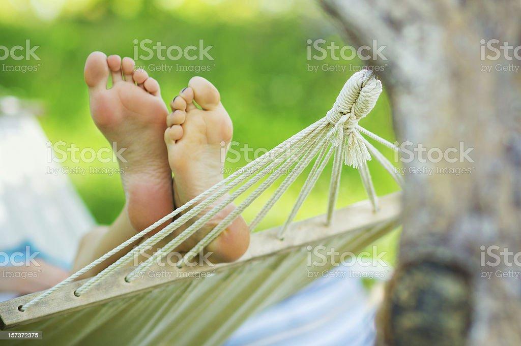 Woman feet in hammock royalty-free stock photo