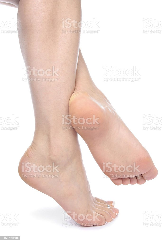 Woman feet isolated over white background stock photo