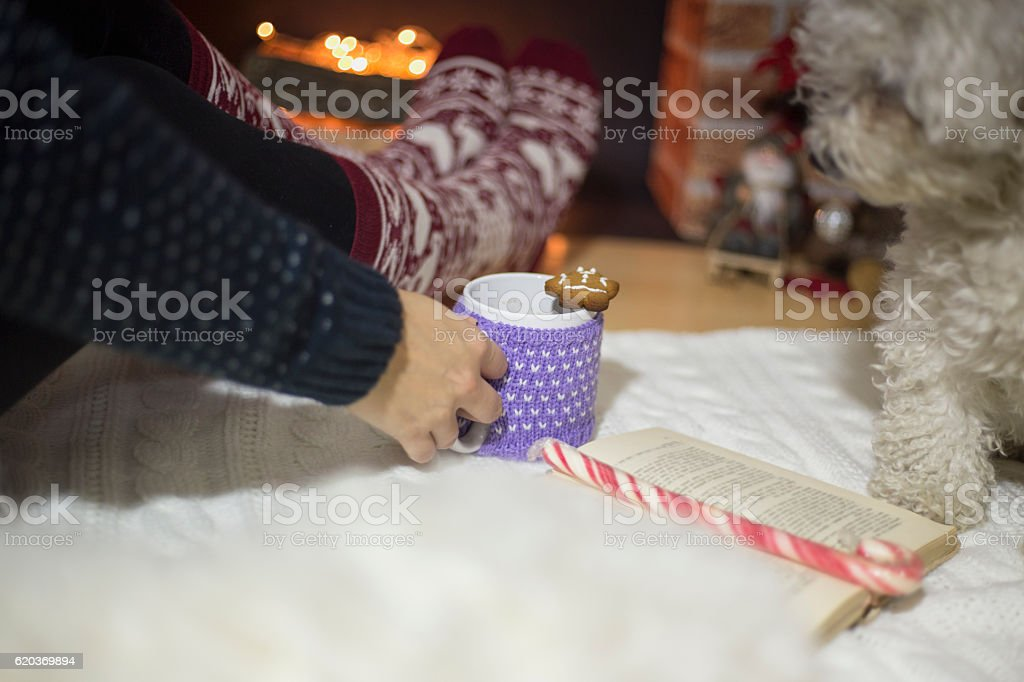 Woman feet near the cup of hot drink zbiór zdjęć royalty-free